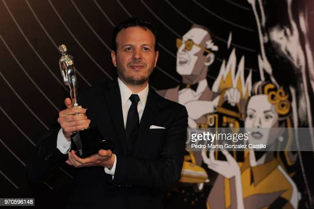 Amat Escalante poses with the Ariel Award for Best Director for 'The Untamed' during 60th Ariel Awards at Palacio de Bellas Artes on June 5 2018 in...