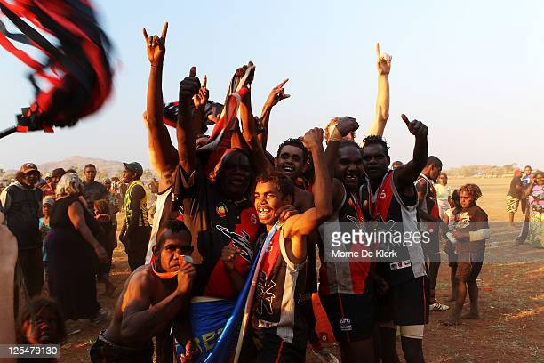 Amata players and fans celebrate after the Far North West Sports League football grand final between Amata and Wintjalangu on September 17, 2011 in...