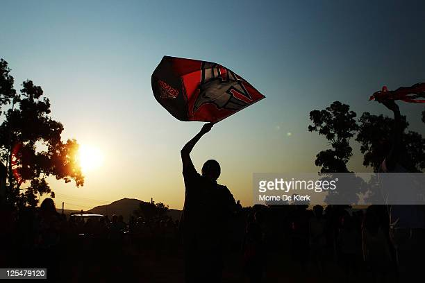 Amata supporters celebrate their team winning the grand final after the Far North West Sports League football grand final between Amata and...