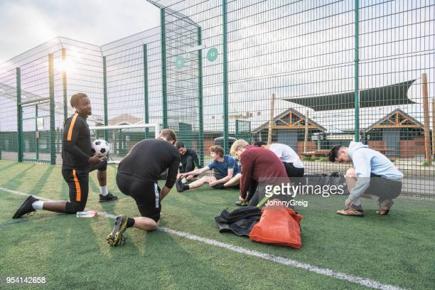 amateur 7 aside football team getting ready for game - sideline stock pictures, royalty-free photos & images