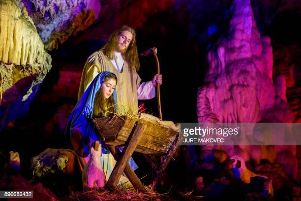 Amateur actors perform as Virgin Mary and Joseph during a Live Nativity Scene in the Postojna Cave on December 21 2017 in Postojna Slovenia The Live...