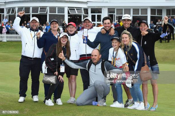 Amateur Alfie Plant of England celebrates with family and friends and holds the Siver Medal for finishing the low amateur during the final round of...