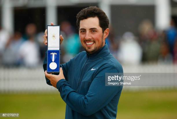 Amateur Alfie Plant of England holds the Silver Medal awarded to highest placed amateur on the 18th green during the final round of the 146th Open...