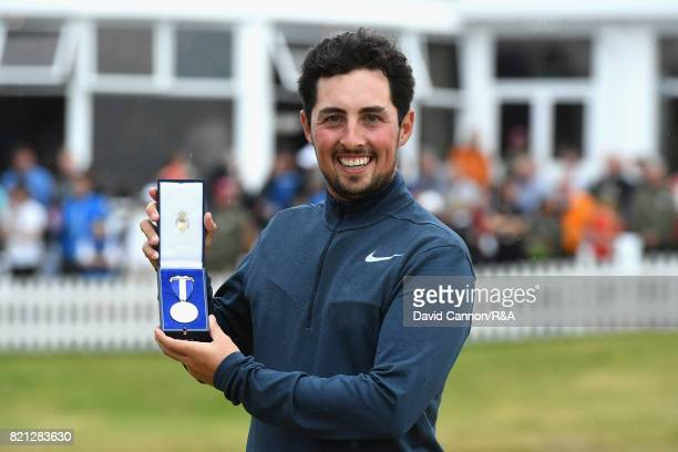 Amateur Alfie Plant of England holds the Siver Medal for finishing the low amateur during the final round of the 146th Open Championship at Royal...