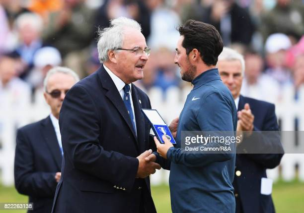 Amateur Alfie Plant of England is presented with the Siver Medal for finishing the low amateur during the final round of the 146th Open Championship...