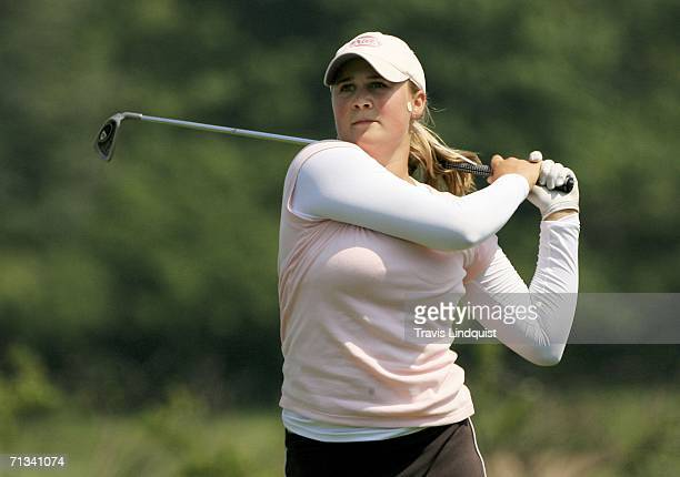 Amateur Amanda Blumenherst watches her tee shot on the fourth hole during the first round of the 2006 Women's US Open at Newport Country Club on June...