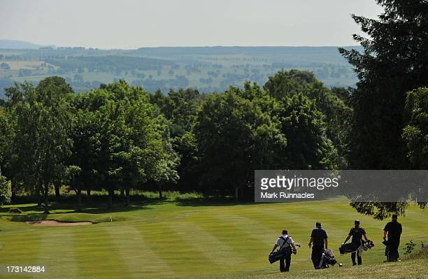 Amateur and pro pairs walk down the 15th fairway during The Lombard Trophy Regional Qualifier at Crieff Golf Club on July 08 2013 in Crieff Scotland
