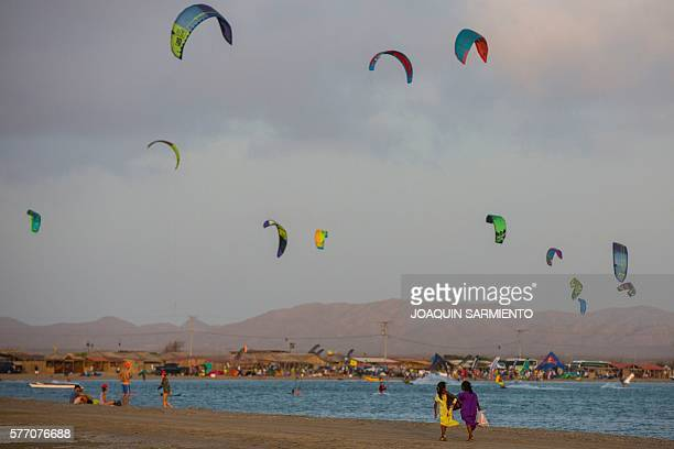 TOPSHOT Amateur and professional kitesurfers are pictured in Cabo de la Vela Guajira Department Colombia on July 4 2016 In Cabo de la Vela a remote...