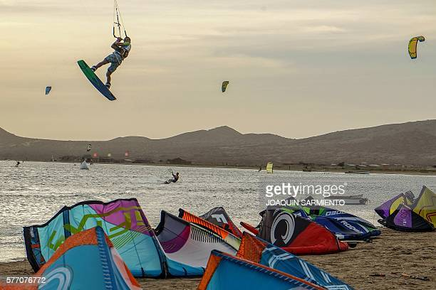 Amateur and professional kitesurfers are pictured in Cabo de la Vela Guajira Department Colombia on July 4 2016 In Cabo de la Vela a remote...
