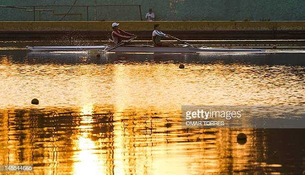 Amateur athlets train at the canoeing track of Mexico city on June 01, 2012. AFP PHOTO/OMAR TORRES