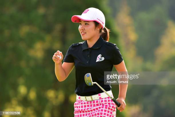 Amateur Ayaka Furue of Japan celebrates winning the tournament on the 18th green during the final round of Fujitsu Ladies at Tokyu Seven Hundred Club...