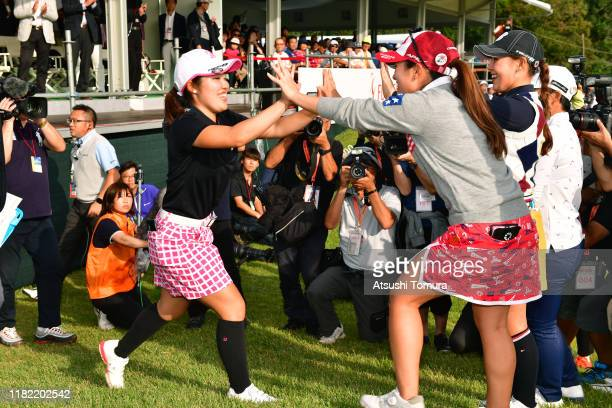 Amateur Ayaka Furue of Japan high fives with amateurs Yuna Nishimura and Yuri Yoshida after winning the tournament following the final round of...