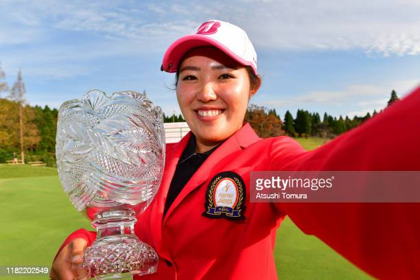 Amateur Ayaka Furue of Japan imitates selfie photographs after the award ceremony following the final round of Fujitsu Ladies at Tokyu Seven Hundred...