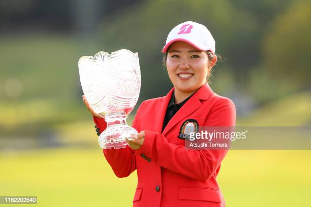 Amateur Ayaka Furue of Japan poses with the trophy at the award ceremony following the final round of Fujitsu Ladies at Tokyu Seven Hundred Club on...