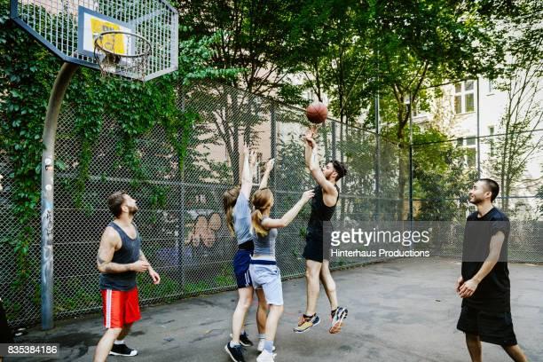 Amateur Basketball  Player Jumping To Take A Shot