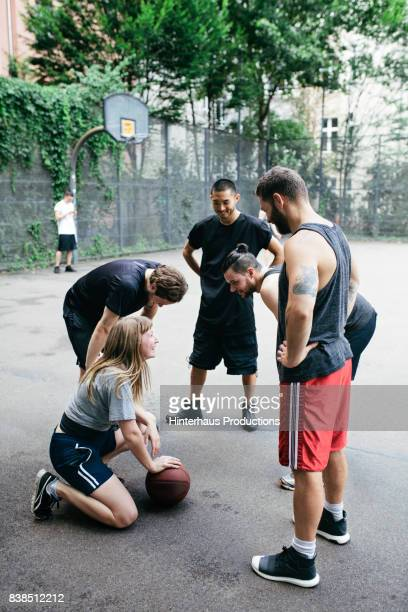 Amateur Basketball Team Discussing tactics Mid Game
