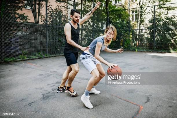 Amateur Basketballer Defending The Ball From Opposing Team Player