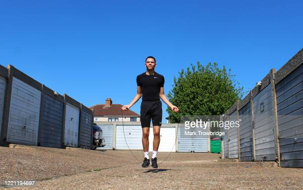 Amateur boxer Ellis Trowbridge trains at his home whilst on lockdown on April 26, 2020 in Worcester Park, United Kingdom. The British government has...