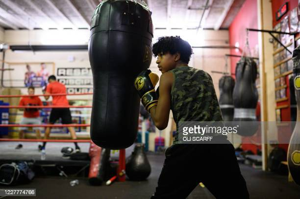 Amateur boxer Roman Singh-Digwa takes part in a training session at the Moss Side Fire Station Boxing Club in Manchester, northwest England, on July...