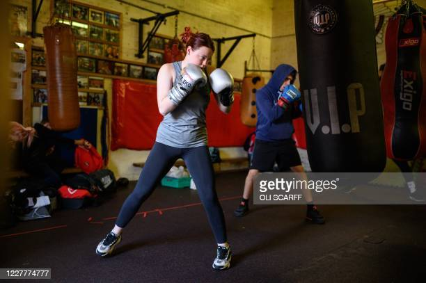 Amateur boxers take part in a training session at the Moss Side Fire Station Boxing Club in Manchester, northwest England, on July 25, 2020 as novel...