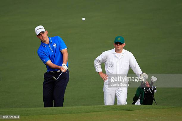 Amateur Bradley Neil of Scotland chips to a green during a practice round prior to the start of the 2015 Masters Tournament at Augusta National Golf...