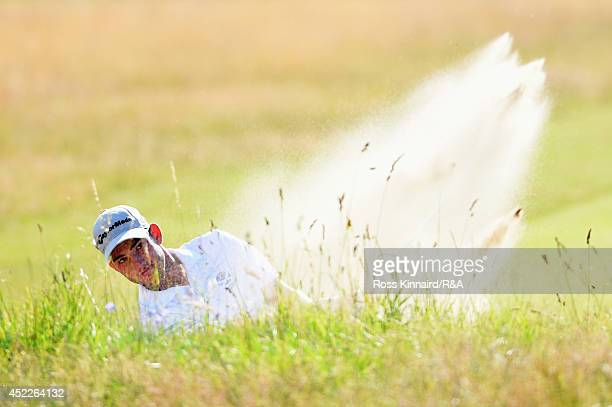 Amateur Bradley Neil of Scotland hits his second shot from a bunker on the fifth hole during the first round of The 143rd Open Championship at Royal...