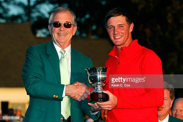 Amateur Bryson DeChambeau of the United States celebrates with Chairman of Augusta National William Porter Payne after finishing as the low amateur...