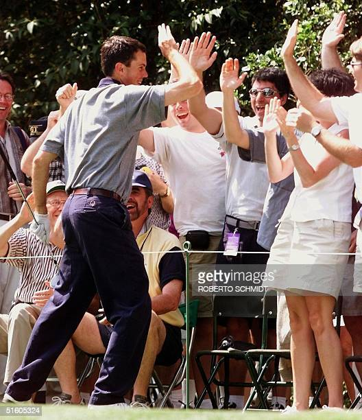Amateur Champion 1997 Matt Kuchar high fives fans after making a holeinone on the second hole of the parthree tournament 07 April at the Augusta...