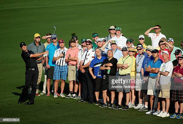 Amateur Corey Conners of Canada hits an approach shot on the second hole as a gallery of patrons look on during the first round of the 2015 Masters...