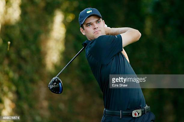 Amateur Corey Conners of Canada watches his tee shot on the second during the first round of the 2015 Masters Tournament at Augusta National Golf...