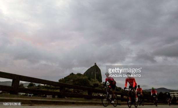 Amateur cyclists ride before the start of the Giro de Rigo in Guatape, Antioquia Department, on November 4, 2018. - The Giro de Rigo is an amateur...