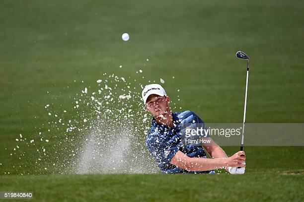 Amateur Derek Bard of the United States plays a shot from a bunker on the second hole during the second round of the 2016 Masters Tournament at...
