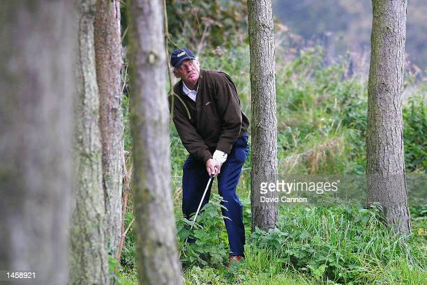 Amateur Dermot Desmond of Ireland plays out of the trees on the 12th hole during the second round of the Dunhill Links Championship at Kingsbarns...