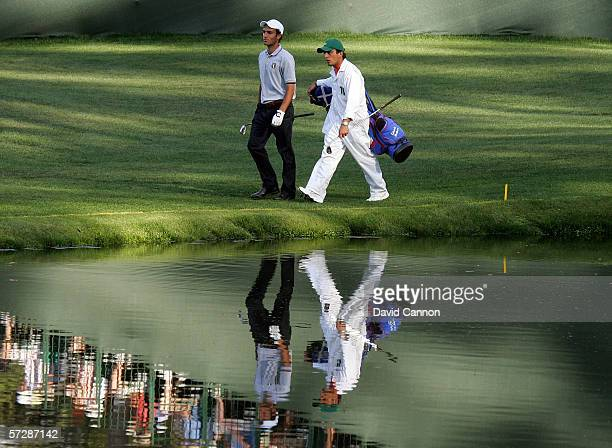 Amateur Edoardo Molinari with his caddie Francesco Molinari walk to the 16th hole during the second round of The Masters at the Augusta National Golf...