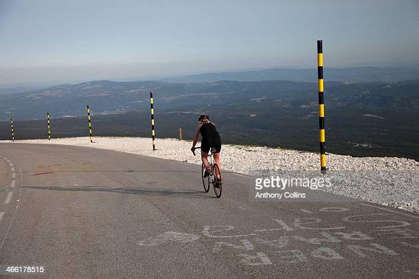 Amateur female cyclist riding back down Mont Vento