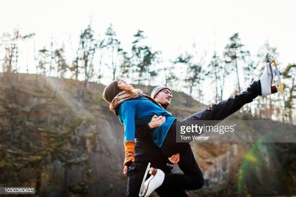 amateur figure skating couple practicing outdoors - eiskunstlauf stock-fotos und bilder