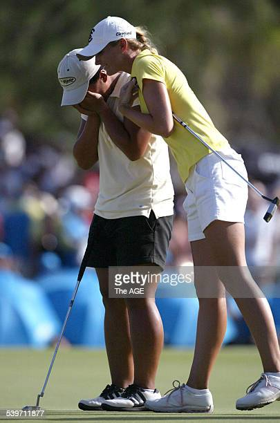 Amateur golfer Amy Yang is hugged by runnerup Catherine Cartwright after winning the ANZ Ladies Masters at Royal Pines on the Gold Coast 5 February...