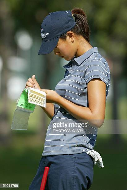 US amateur golfer Michelle Wie looks at her scorecard during the 3rd day of practice rounds at the US Women's Open at the Orchards Golf Club in South...