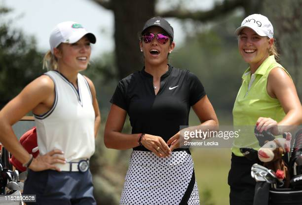 Amateur golfers Sierra Brooks Maria Fassi of Mexico and Jennifer Kupcho wait to hit on the 10th tee box during the second round of the US Women's...