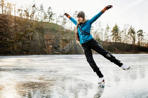 Amateur Ice Skater Posing On Frozen Lake - gettyimageskorea