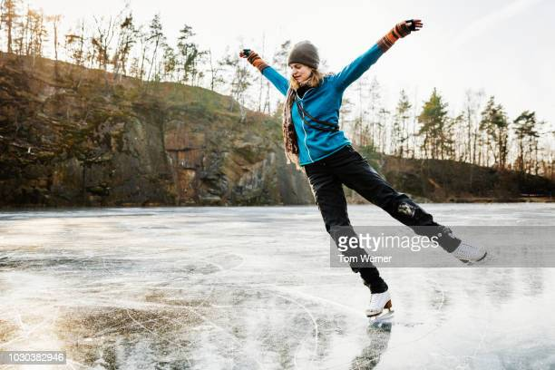 amateur ice skater posing on frozen lake - ice skate stock pictures, royalty-free photos & images