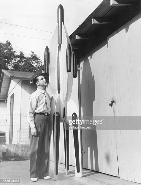 Amateur inventor Maurice Poirier with his new 12foot stratosphere rocket in Burbank California 1937