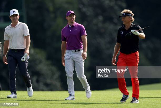 Amateur John Augenstein of the United States, Rory McIlroy of Northern Ireland and Bernhard Langer of Germany walk on the eighth hole during the...