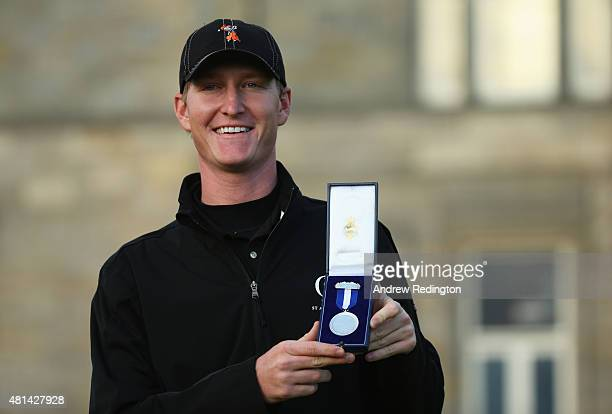 Amateur Jordan Niebrugge of the United States holds the Silver Medal awarded to highest placed amateur after the final round of the 144th Open...