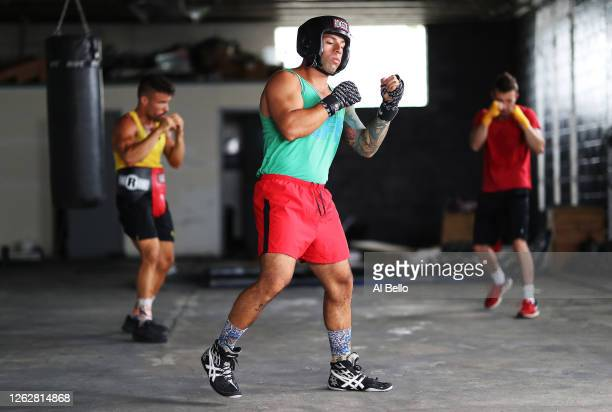 Amateur Kickboxer Sal Carillo New York Golden Gloves boxer Dennis Guerrero and three time New York Golden Glove boxer Anthony Lopez shadowbox during...