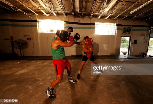 Amateur kickboxer Sal Carillo spars with New York Golden Gloves boxer Dennis Guerrero during a final boxing workout at Jetty gym on July 30 2020 in...