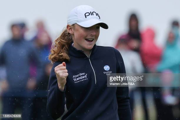 Amateur Louise Duncan of Scotland celebrates a birdie on the eighteenth hole during Day Three of the AIG Women's Open at Carnoustie Golf Links on...