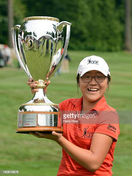 Amateur Lydia Ko of New Zealand poses with the trophy after the final round of the Canadian Women's Open at The Vancouver Golf Club on August 26,...