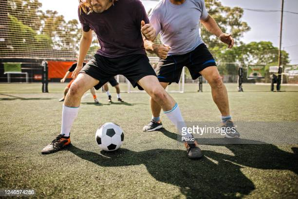 amateur male soccer team playing soccer outdoor - shooting at goal stock pictures, royalty-free photos & images