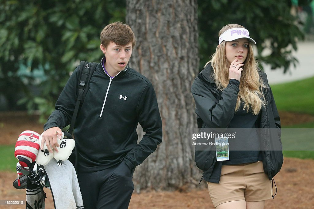 Amateur Matthew Fitzpatrick of England walks with girlfriend Amy during a practice round prior to the start of the 2014 Masters Tournament at Augusta National Golf Club on April 7, 2014 in Augusta, Georgia.